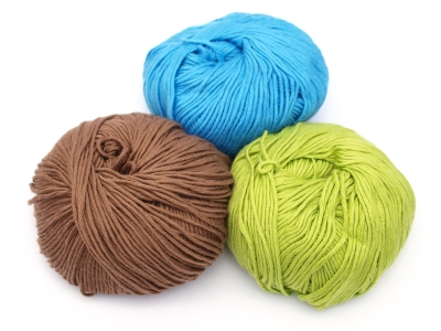 brown blue and green yarns wooden spools quilting knitting more