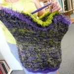 "...she used Rio de la Plata puple, black & lime wool (felts beautifully) with Crystal Palace ""Splash"" eyelash yarn."