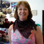 "Here's Liz Haskins modeling the ""Summer Mystery Shawlette"" (Wendy Johnson pattern)"