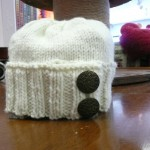 This very stylish hat was knitted by Sheila Sanchez with Dark Horse Baby Worsted !