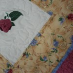 ...to go with the embroidered flowers in the center of each block!