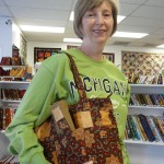 "Here's Sue Harper showing her very cool ""Baja Purse"" made with fall fabric!"