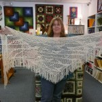"Terri Randolph's ""White Gold Shawl w/Birds"" she used Filatura De Crosa Luxury, with some Elsbeth Lavold silky wool and Berroco Bonsai for for fringe!!!"