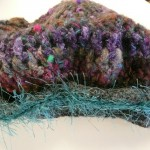 "Rae Misek's ""Henry the VIII"" hat crocheted with Noro Blossom & Gray Alpaca for the brim.  Rae says ""It took years to get the right brim size for a 16th century English Cap - the journey was fun!"""