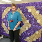 Kristie shows off her new quilt made by Step-Mom, Ruth Erickson!