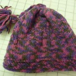 "Holly knitted this baby hat with Karabella Yarns Extrafine Merino - (From the book ""Baby Beanies"").  And...she machine washed & dried it - and it came out beautifully!!!"
