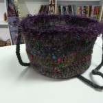 This small shoulder bag was crocheted by Rae Misek using Noro Blossom