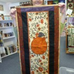 Mona Steerman found just the right fabrics for the border of her Pumpkin Table Runner!