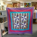 "James Hall started this ""Flying Around the Pinwheels"" quilt 17 YEARS AGO - IN OKINAWA - and found binding fabric to finally finish it!!!"