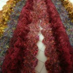 "A Rae Misek crocheted creation using Trendsetter ""Dune"", ""Heavenly"", rosy wool, mohair and eyelash yarn."