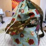 Lisa Brown made this drawstring sling bag for her knitting.  It's an Amy Butler pattern.  NICE!