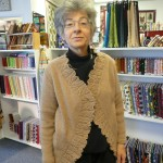 "Carol Hirshman made the pattern ""Inca Marl Ruffled Coat"" her own by making it a bit shorter and adding the ruffle.  Wow.  She used Rowan Alpaca DK weight."