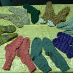 "The graduates of ""Knitting Socks: Step by Step"" taught by Audrey Cheadle, show off their work!!  Well Done!"