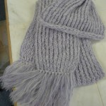 "Caryl Dean knitted this fabulous scarf on a double rake loom and the hat on a round loom with Adrienne Vittadini's ""Natasha"" and Lana Grossa ""Baby Kid"" mohair"