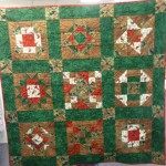 This is our own Taffy's Christmas Sampler Quilt - machine pieced and hand quilted!!