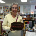Sue Lavoie shows her clothesline fabric bowl that she made in class (taught by Scott Farmer)
