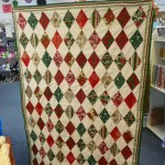 This beautiful Christmas Harlequin quilt was hand pieced by Karen Peregoy.  Would you believe it's just her third quilt? It's a gift for her lucky sister!