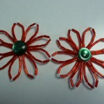 Lynn VanLeer found the perfect little green buttons to complete these beaded holiday flower pins she made!