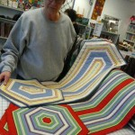 What do you do with striped fabric?  Marcia Koester made these fabulous table runners and placemats using the Clearview Triangle ruler!