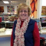 This ruffle scarf was knitted by Ruth Ross with Tecido Trico.  It is a self-ruffling fabric - with holes on the side that you knit in - and voila! a beautiful scarf - this one knitted by and modeled by Ruth Ross!