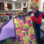 Ruth also found fabric to border and finish up this fun, bright quilt!!