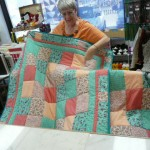These lovely teal and salmon Children's Sudoku quilts were made by Daisy Sedalnick - all but the binding came from Wooden Spools!