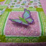 Jessica embroidered 3-D butterflies onto the quilt!.....