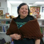 Alice Woods used Baby Alpaca to crochet this shell stitch shawl - and had the terrific idea of using Tinseltown (a self ruffling ribbon yarn) on the edge!