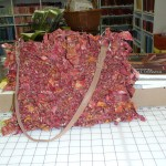 "This is soooo cool!  It's a purse knitted with fabric!  Barbara Carlson is its creator.  She used 3 1/2 yards of fabric - Batik is best - cut on the bias - 1"" - all knit!  Love.It.!"