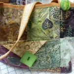 "This fun bag is made with batik 5"" squares - by Virginia Feld.  Adorned with the perfect button from Wooden Spools :-)"