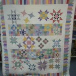 This quilt is amazing.  It's a block of the month that has been modified a bit.  Gail Spring is it's creator.....and check out the back .....