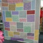"...the back is the ""Big Block Quilt"" pattern - and Gail used the leftover fabrics.  Absolutely gorgeous!!"