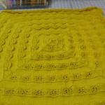 "Saundra Fowler knitted this fantastic cotton baby blanket with Stacy Charles Cotton Classic.  The pattern is ""Alpaca Baby Blanket""  We sure like it in the bright yellow cotton!!"