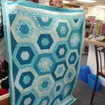 Brenna Deutchman made two sympathy quilts for a mother & daughter - both with a hexagon pattern....
